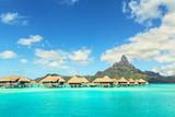 Otemanu mountain and luxury bungalow at Bora Bora island, Tahiti, French Polynesia - 183434497