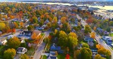 Colorful neighborhoods of Sturgeon Bay, Wisconsin, Autumn aerial flyover.  - 183437835