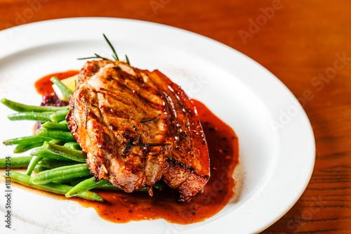 Plexiglas Steakhouse meat steak with red cabbage