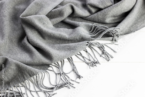 Background texture of the crumpled gray winter fashionable female scarf Poster