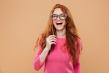 Portrait of a cheerful pretty redhead girl - 183447017
