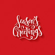 SEASON'S GREETINGS brush calligraphy on red giftwrap background
