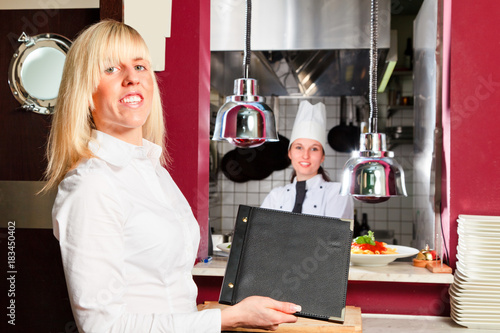 Waiter And Chef In Restaurant