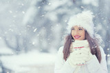 Beautiful smiling young woman in warm clothing with cup of  hot tea coffee or punch. The concept of portrait in winter snowy weather - 183450645