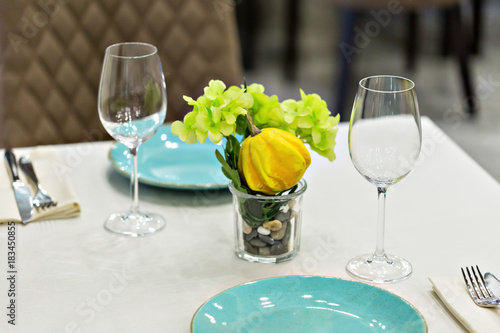 Fototapeta close up of table setting with glasses and cutlery