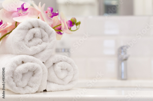 Staande foto Bali Stack of towels with flower decor in a hotel room