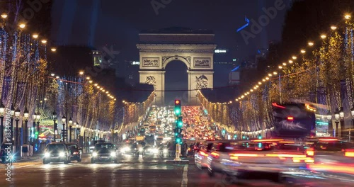 Christmas in Paris. Timelapse of avenue des Champs-Elysees with Christmas lighting leading up to the Arc de Triomphe in Paris, France. Zoom in effect.