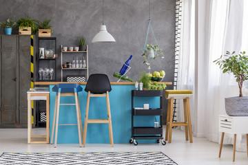 White lamp above blue kitchenette