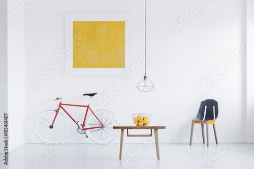 White apartment with gold painting