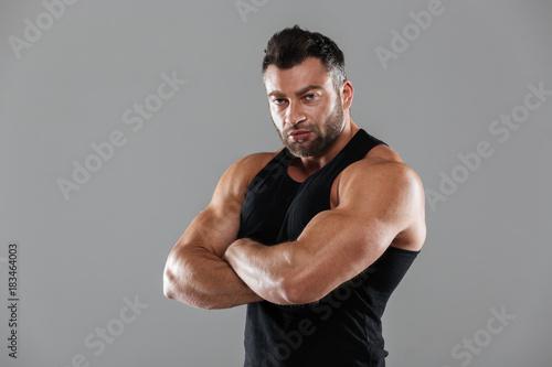 Plexiglas Fitness Portrait of a serious strong male bodybuilder