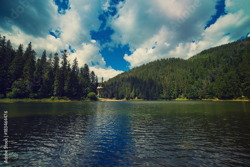 Papiers peints Bleu vert Carpathian mountains summer landscape with lake Sinevir and dramatic cloudy sky, natural background