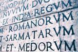 Latin inscription on the outside wall of Ara Pacis wall in Rome, Italy - 183465247