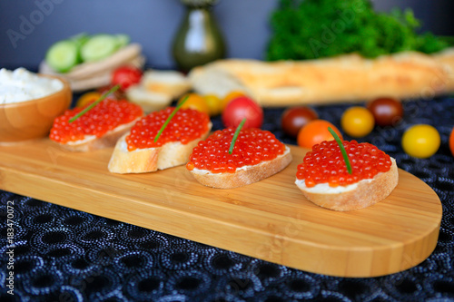 Sticker Close up of four sandwiches with red caviar