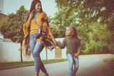 Daughter walking street holding hands her Mother. - 183473475