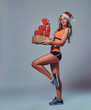 Female holds Christmas gifts.