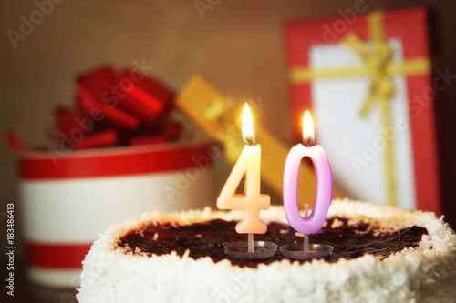 Poster Fourty years birthday. Cake with burning candles and gifts