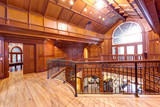 Second floor landing accented with wood paneled walls and ceiling. - 183490672