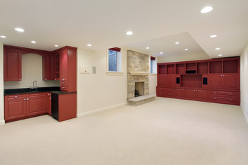 Basement with red wood cabinetry