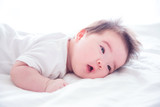 Little asian baby girl waking up on bed in the morning - 183494296