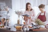 Happy grandmother mixing ingredients - 183497427