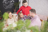 Family eating together christmas meal - 183497482
