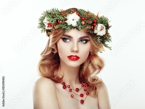 Foto op Canvas Kapsalon Portrait of beautiful young woman with Christmas wreath. Beautiful New Year and Christmas tree holiday hairstyle and makeup. Beauty girl portrait isolated on white background. Colorful makeup and hair
