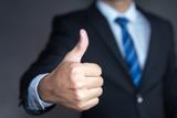 Businessman showing thumbs up - closeup shot - 183510863
