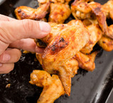 Juicy fried chicken wings in the oven - 183511814