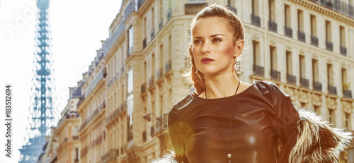 Portrait of trendy woman in Paris, France looking into distance