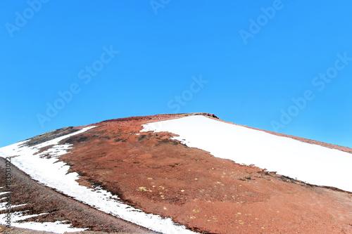 Fotobehang Zalm snow on lava stone on mountain etna