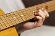 teen boy play the guitar music notes