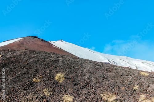 Papiers peints Cappuccino snow on lava stone on mountain etna