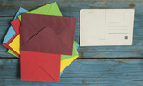 Envelope with card on wooden background - 183514015