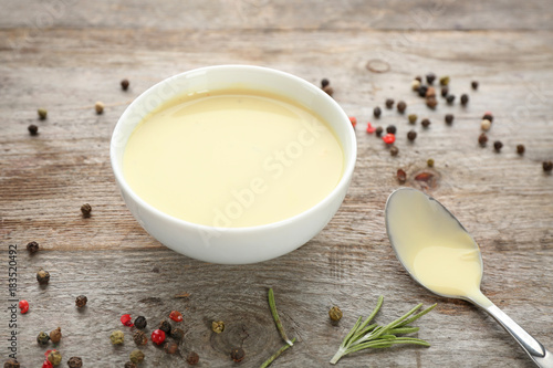 Fotobehang Kruiden 2 Ceramic bowl with ranch salad dressing on wooden background