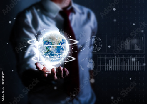 Fotobehang Nasa Businessman holding planet Earth in palm. Elements of this image are furnished by NASA