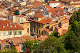 Roofs of Nice in summer with their distinctive terracotta tiles and louvered shutters. French Riviera, Alpes Maritimes, France - 183528617
