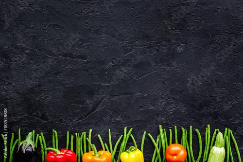 Healthy food. Fresh vegetables on black background top view copyspace