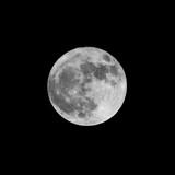 big full moon bright in the black winter sky - 183530208