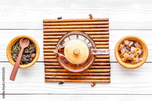 Papiers peints The Tea break. Tea pot, sugar and tea leaves on white wooden background top view