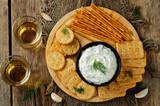 Feta cream cheese dill garlic dip with crackers - 183535099