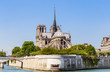 Notre Dame de Paris Catholic Christian Cathedral with the Seine river and  the bridge   Archbishopric on a sunny spring day. Paris