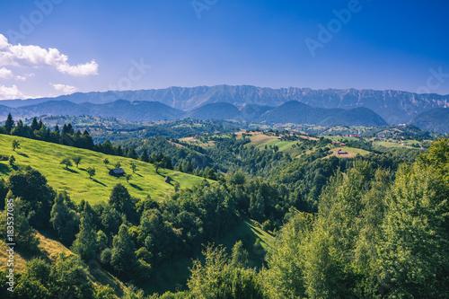 Fotobehang Zomer Stunning alpine landscape and green fields, Transylvania, Romania, Europe