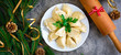 Christmas dumplings with decoration on a grey board. Top view. - 183543881