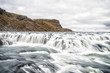 Waterfall in river canyon in Iceland - 183544043