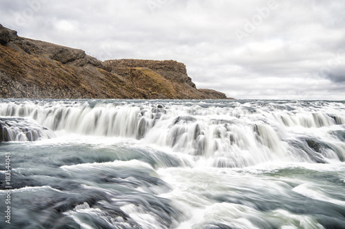 Fotobehang Bergrivier Waterfall in river canyon in Iceland