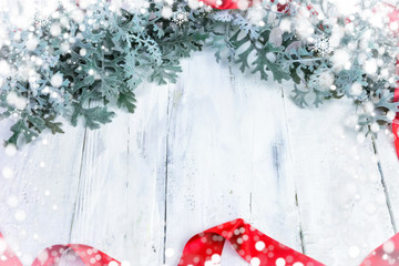 Christmas wooden background with snow branch. Top view with copy space for your text © Vantsura