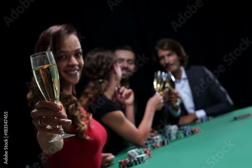 Girl drinking cocktail in casino Poster