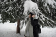 young woman with backpack and headphones on winter day