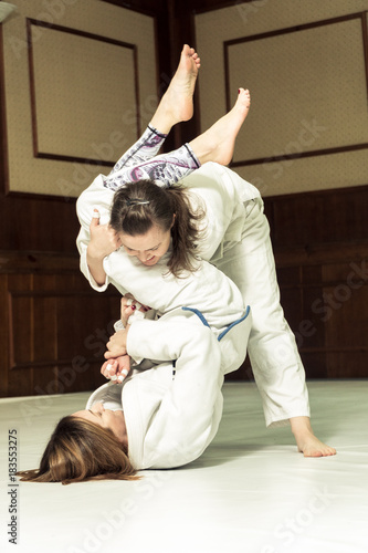 Fight. Girls train for training in judo and jujitsu Poster