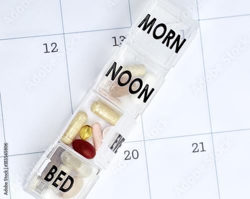 Vitamins in a Pill Box on a Calendar